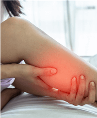 Female experiencing leg pain in bed caused by vein disease