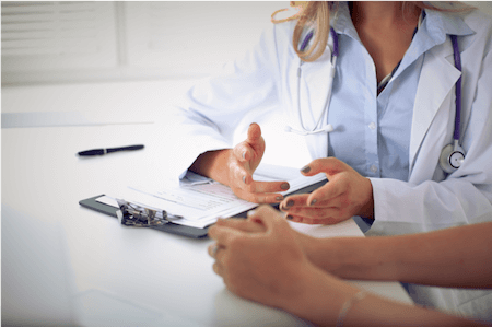 Woman consulting with a VIP Fibroid Specialist in Visalia, CA about Uterine Fibroid Embolization (UFE)